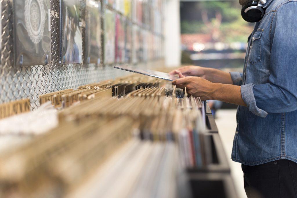 Man browsing vinyl album at David's Used Books & Records
