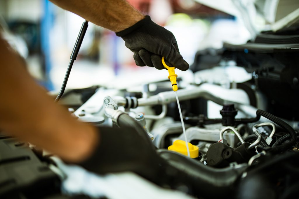 Mechanic demonstrating an oil change.