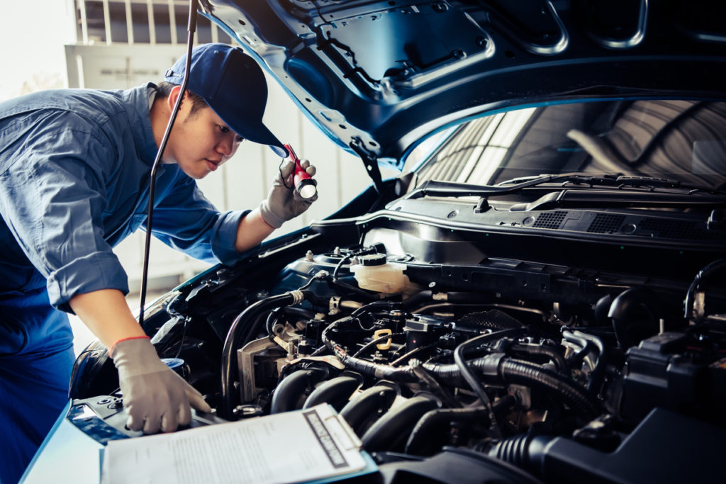 Vehicle technician performing service inspection