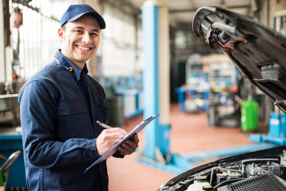 Mechanic happily working on a vehicle